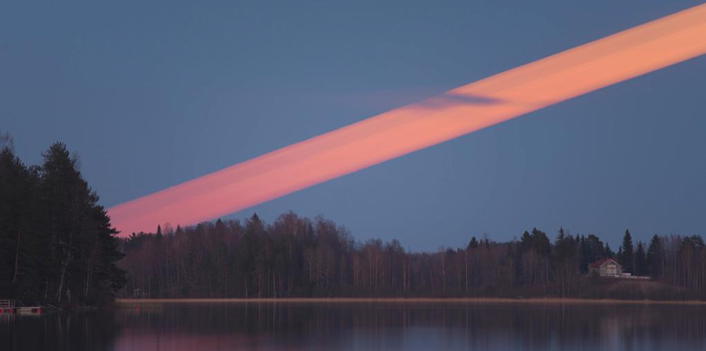 Beautiful moon trail photo reveals a red streak across the sky