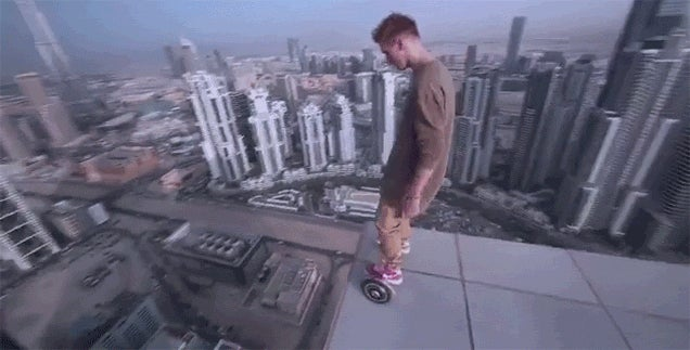 Crazy Daredevil Rides a Hoverboard onto the Very Edge of a Skyscraper