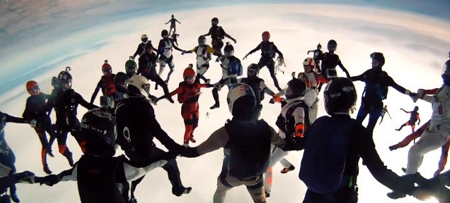 Watch this video of the largest all-female head-first skydive