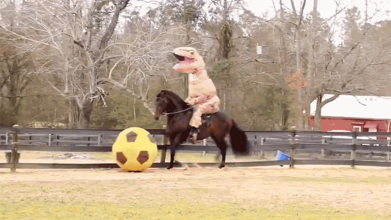 A T. Rex Riding a Horse Kicking a Soccer Ball Is Everything Wonderful About the Internet