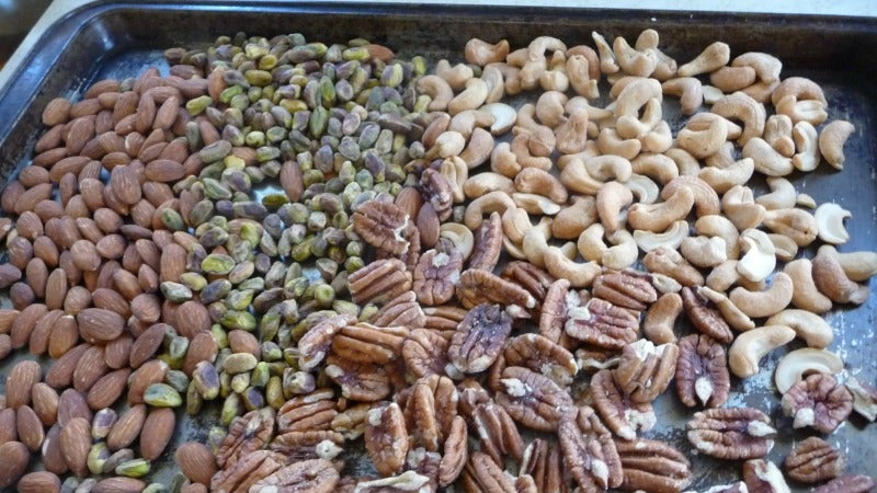 Why You Shouldn't Grind Up Nuts Fresh From The Oven