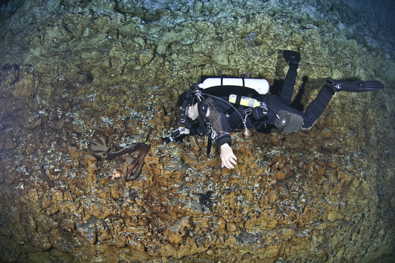 This Diver Is Cradling a 12,000-Year-Old Skull in an Underwater Cave