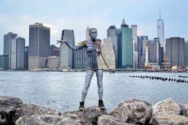 Women's bodies blend into a city's background with just bodypaint