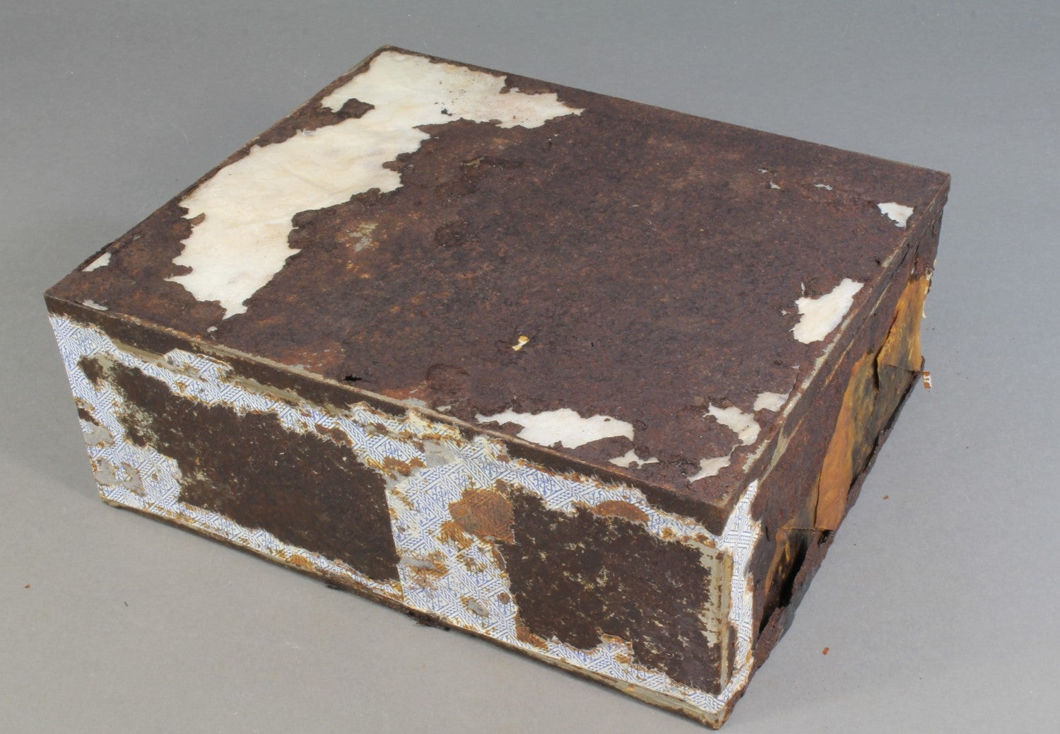 The cake tin had fared worse than the actual cake. (Credit: Antarctic Heritage Trust)
