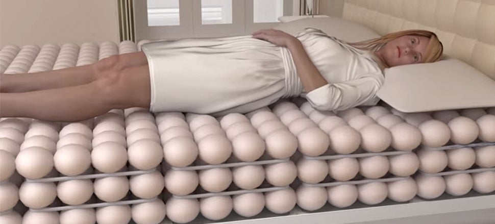 Layers of inflatable balls might just make this the - Bed made of balls ...