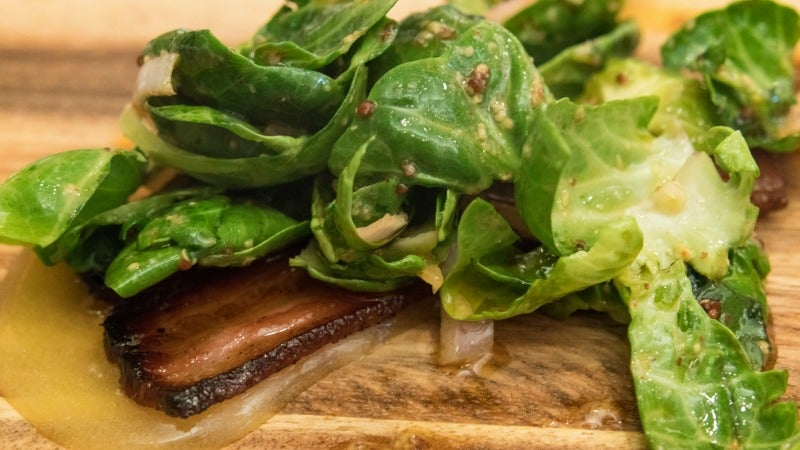 Why You Should Intentionally Wilt Lettuce With A Bacon Vinaigrette
