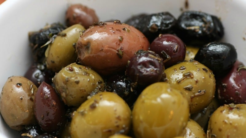 Quickly Pit Olives With the Flat of a Knife