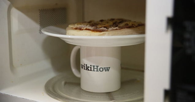 The Secret to Microwaving Day-Old Pizza So It Still Tastes Fresh