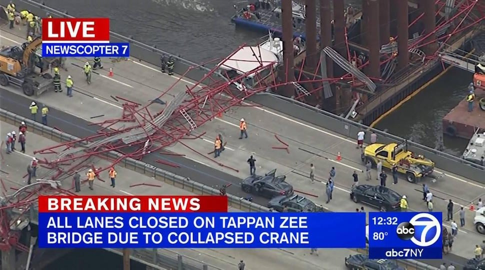 Crane on new bridge topples over onto lanes of old bridge