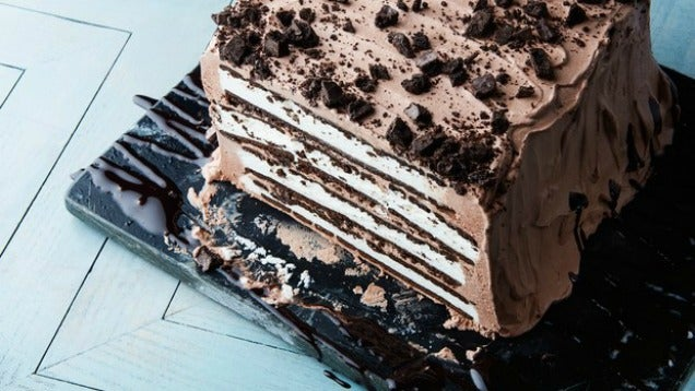 The Easiest, Tastiest Ice Cream Cake Is Just Ice Cream Sandwiches Stacked And Frosted