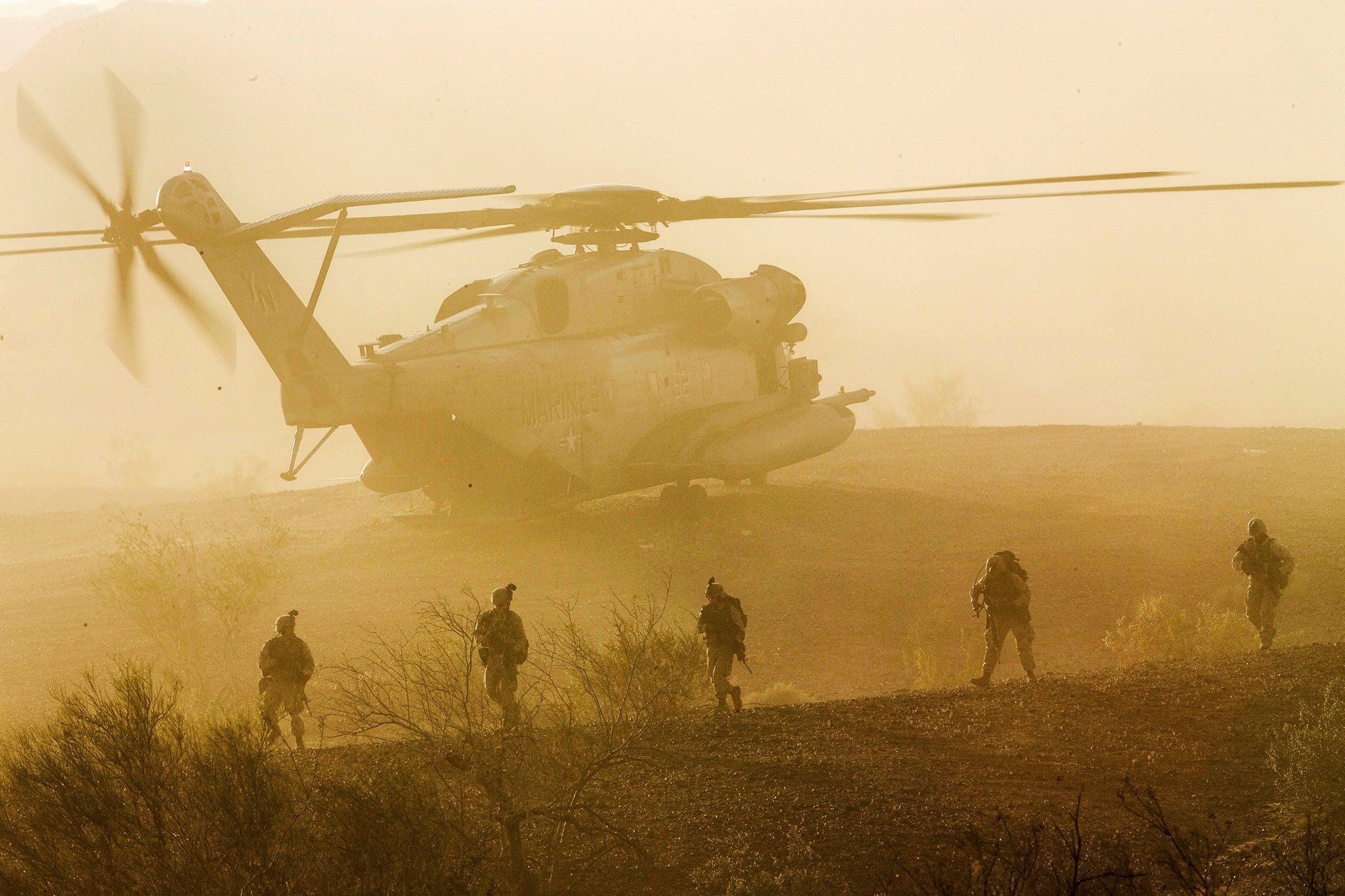 US Marines leaving a Super Stallion helicopter looks like a movie scene