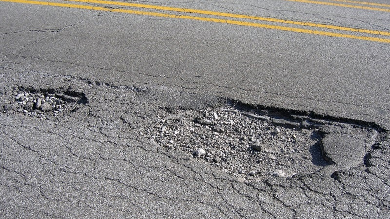 Drive Over Potholes Straight On If You Can't Avoid Them