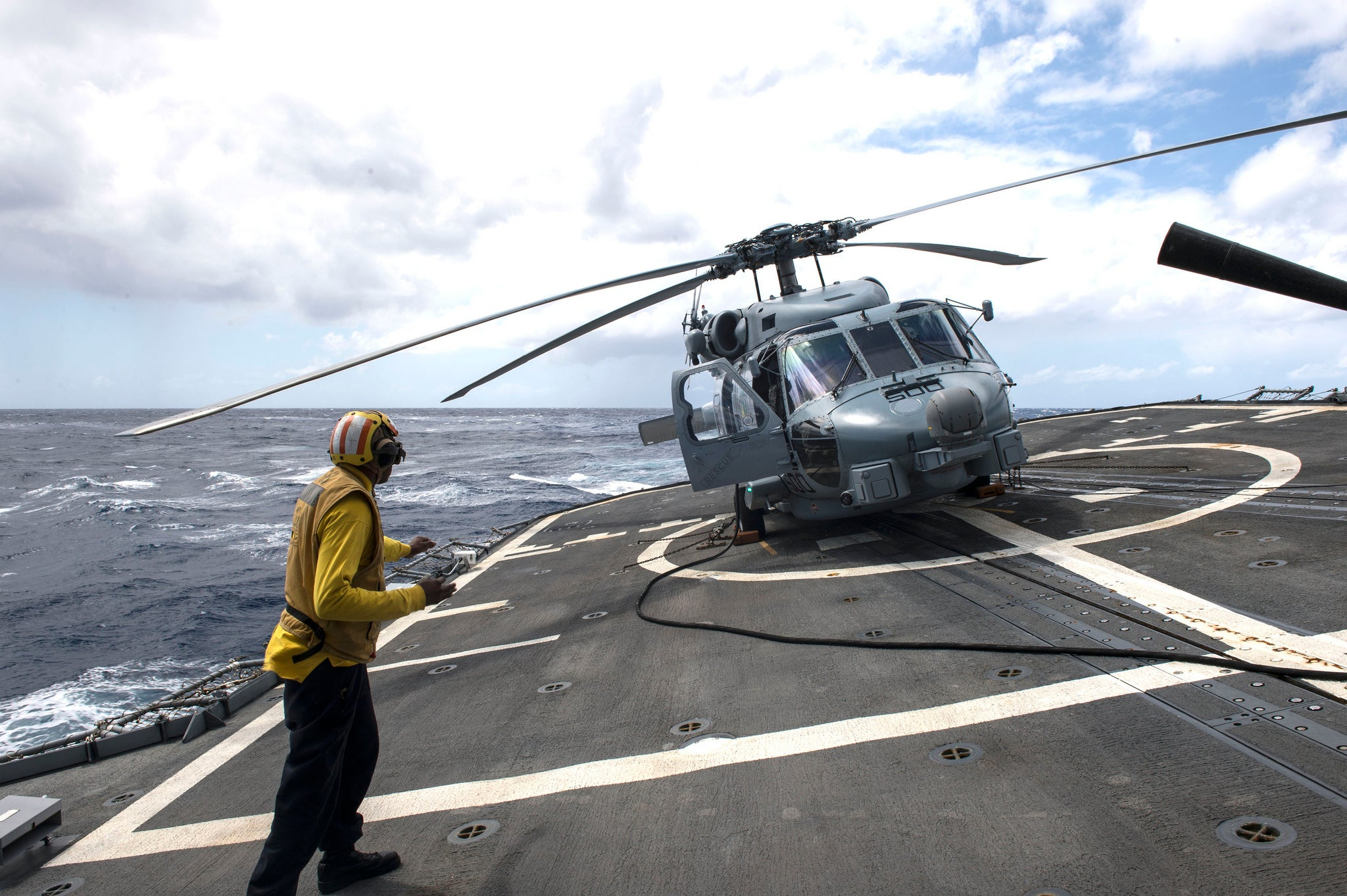 Crazy angle of a US Navy helicopter on a guided-missile cruiser