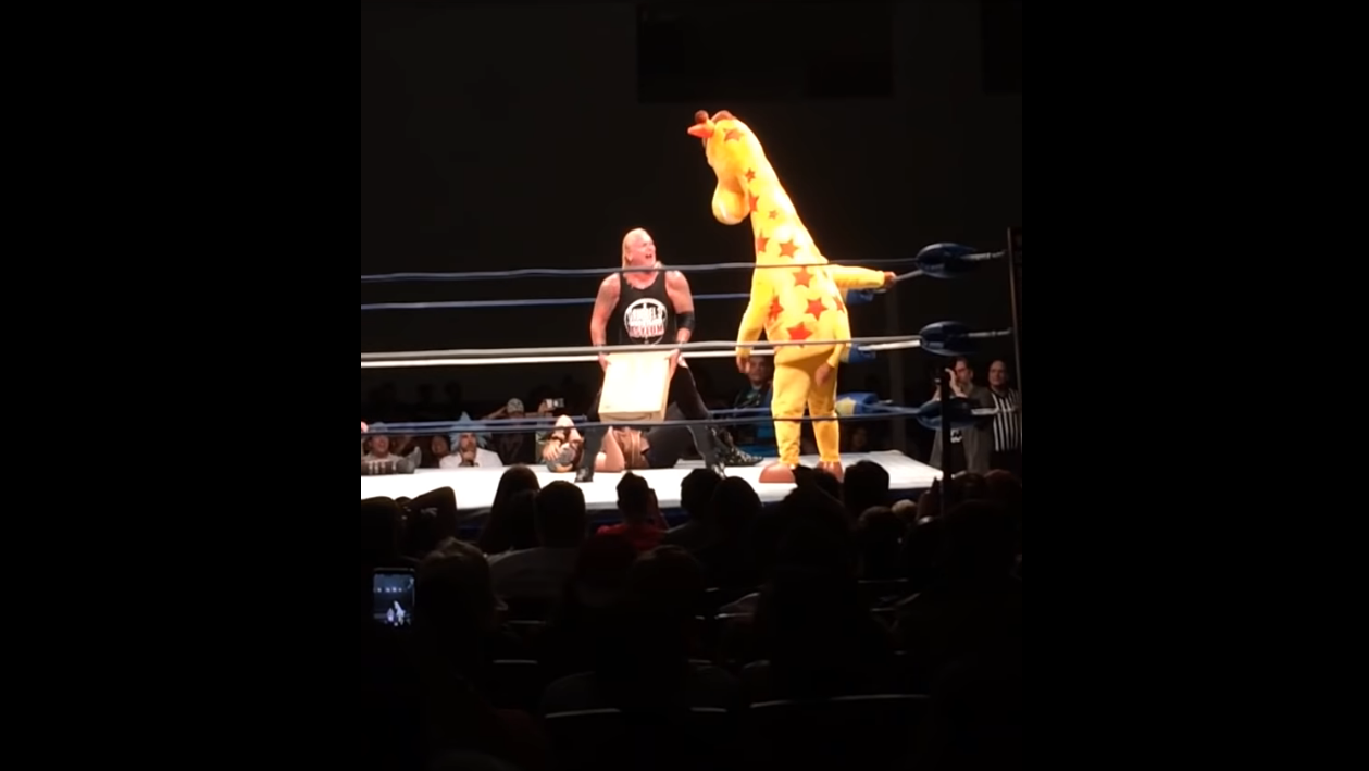 """Watch Toys """"R"""" Us' Geoffrey The Giraffe Get Knocked Out Of The Ring With An Amazon Box"""