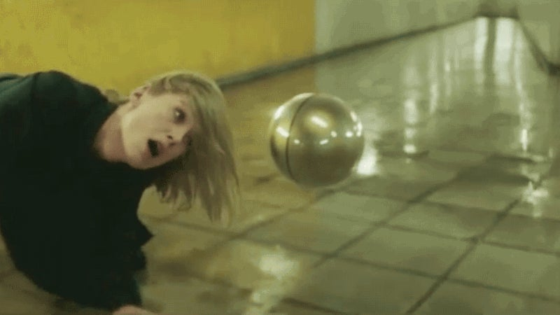 A Floating Orb Menaces Rosamund Pike in This Disturbing New Massive Attack Video