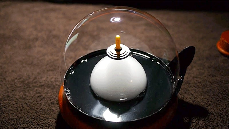 A Spinning Top Floating Inside a Smoke-Filled Bubble Looks Like Magic