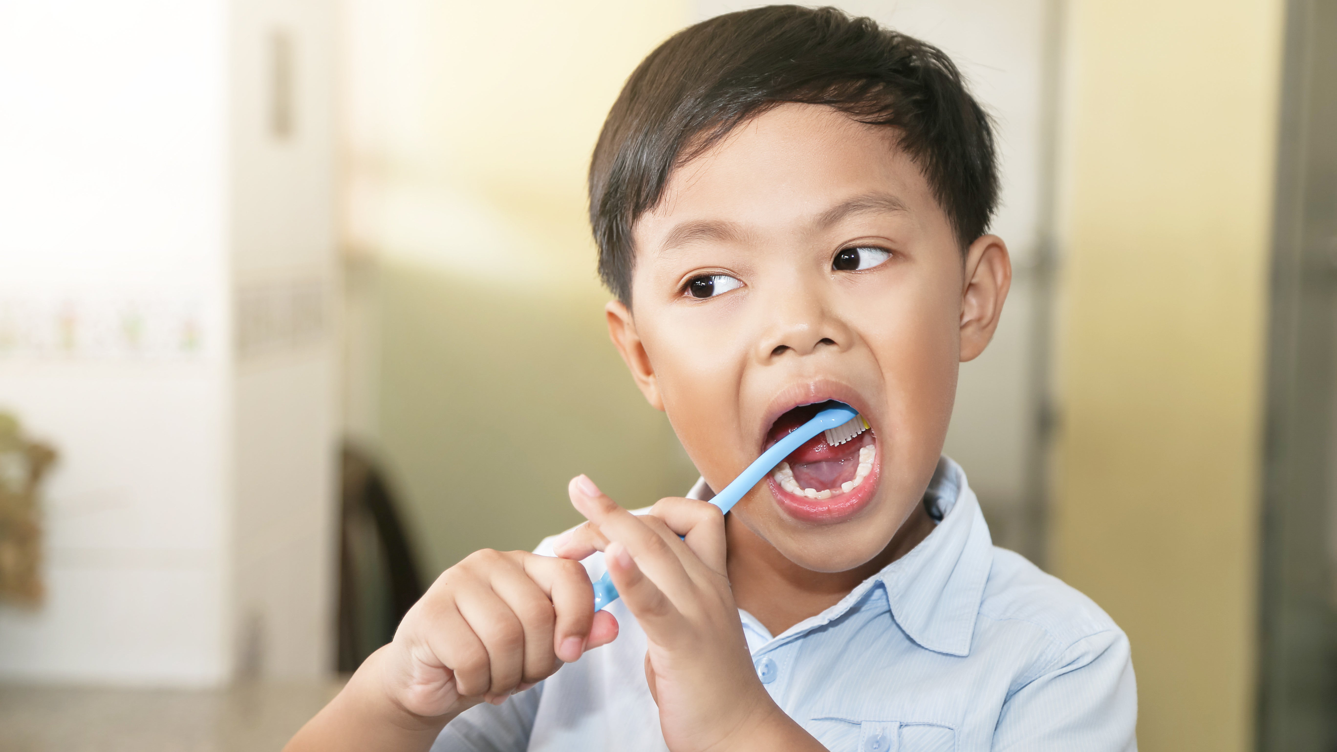 Get Your Kids To Brush Their Teeth With These Tips