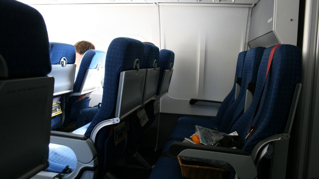 PSA: There's a Secret Button to Raise the Armrest of an Aisle Seat on an Aeroplane
