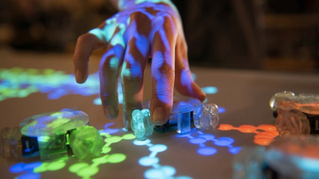 Tiny Robots Add Physical Controls and Dials To Giant Touchscreens