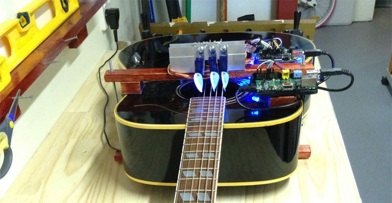 Robotic Player Guitar Shreds On Its Own