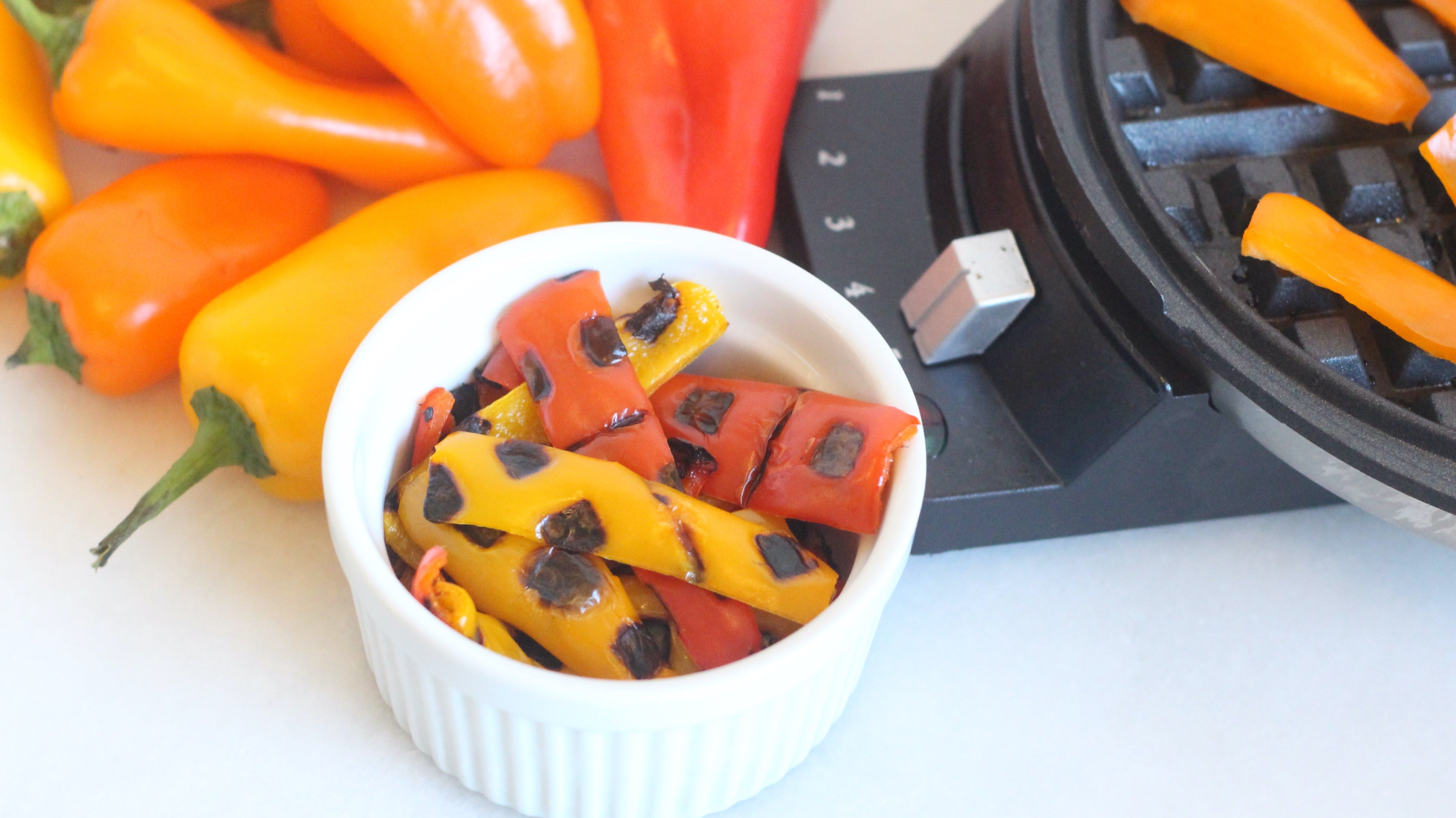 Blister Sizzling Strips Of Bell Pepper In Your Waffle Maker