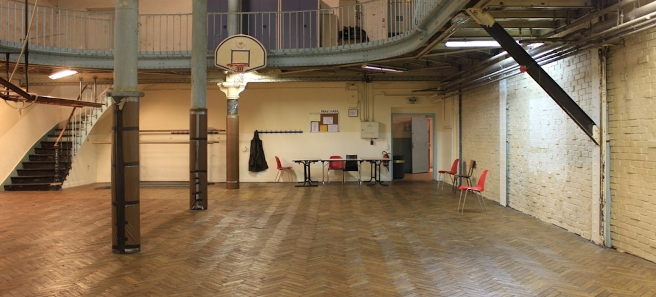 The world 39 s oldest basketball court has iron poles in the for Cheapest way to make a basketball court