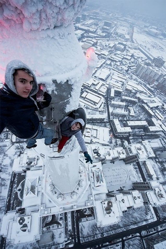 Crazy Ivan climbs atop the frozen crane of the 2073-foot Shanghai Tower
