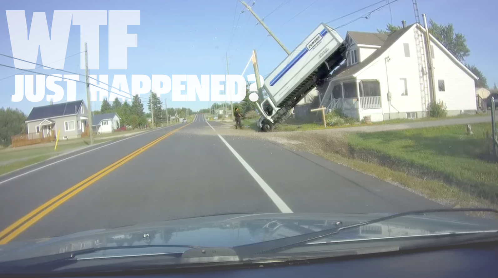 I'm Still Not Exactly Sure How This Dude Managed To Get That Truck Stuck On Top Of A House