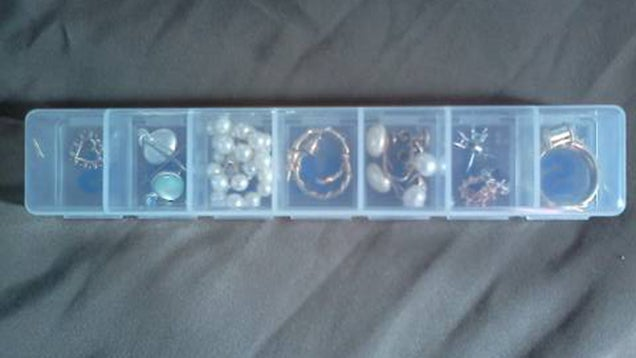 Use a Pill Box to Organise Jewelry and Small Items While Travelling