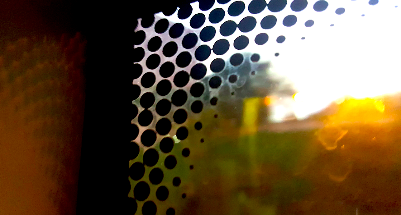 Here's What Those Little Dots On The Edges Of Your Car Windows Are
