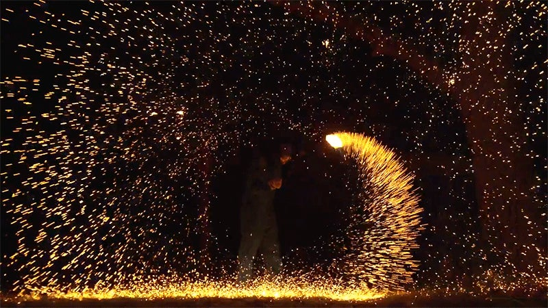 Burning Steel Wool Becomes a Spinning Blade of Fire In Slow Motion