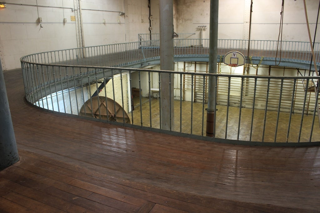 The world's oldest basketball court has iron poles in the middle of it