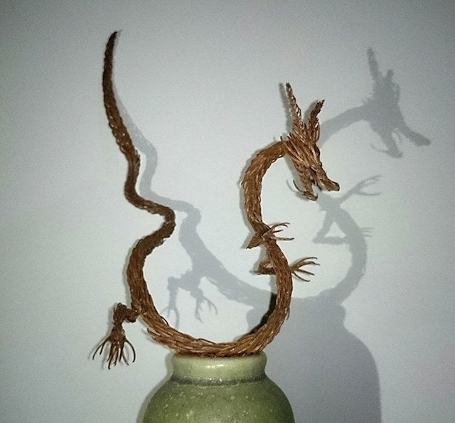 Godzilla Made from Pine Tree Branches Is a Lovely Fire Hazard