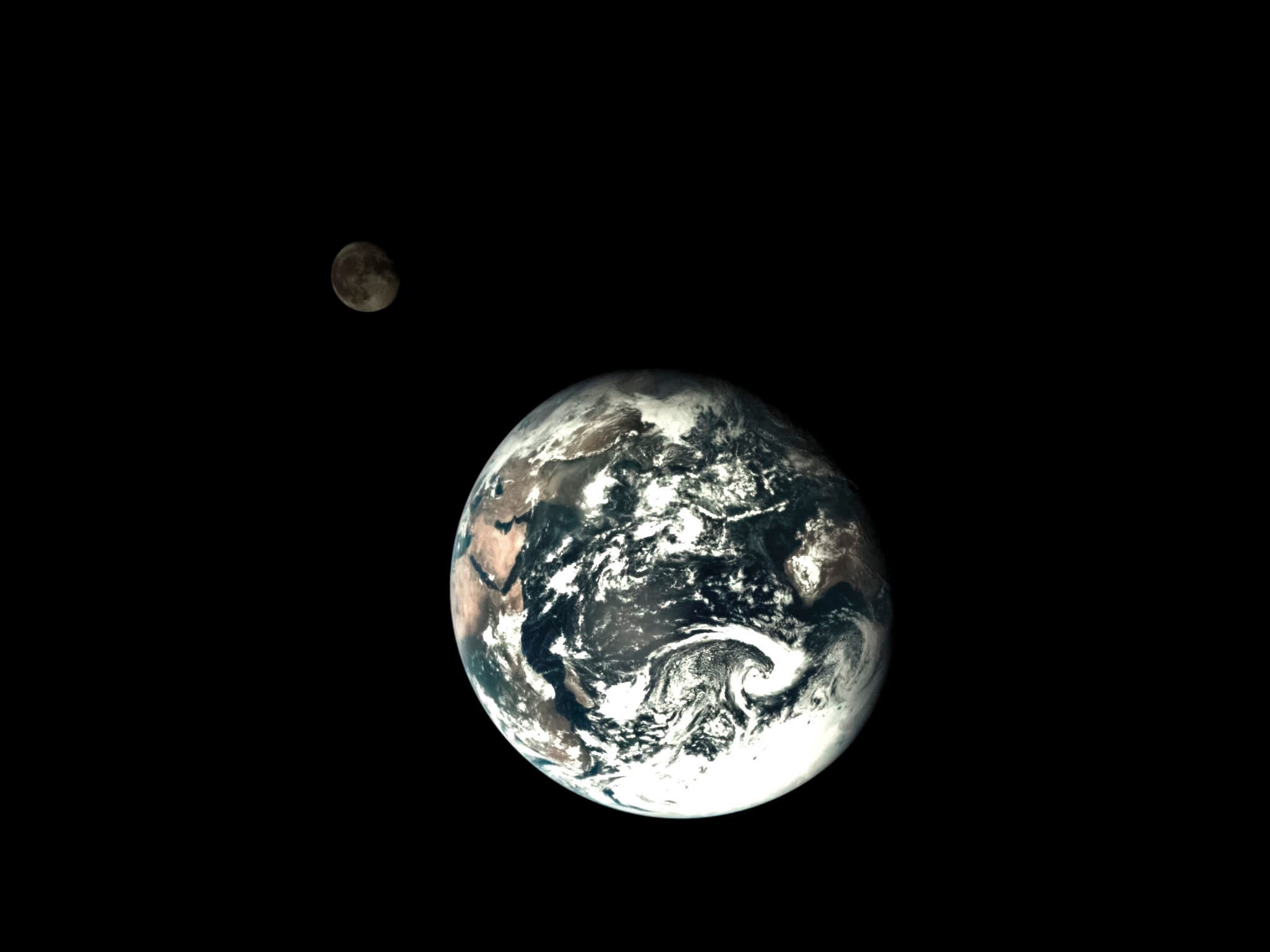 A cool image of the Moon orbiting Earth taken from outer space