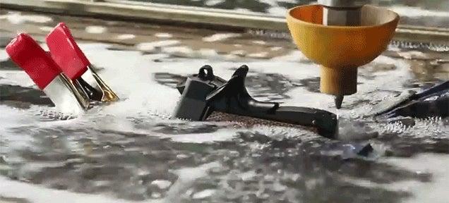 Watch Random Objects Get Cut in Half with a Powerful Waterjet Cutter