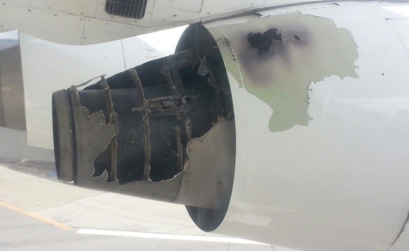 Passenger films one of his aeroplane's engines on fire