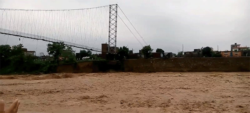 Watch a Raging Flood Devour an Entire Suspension Bridge