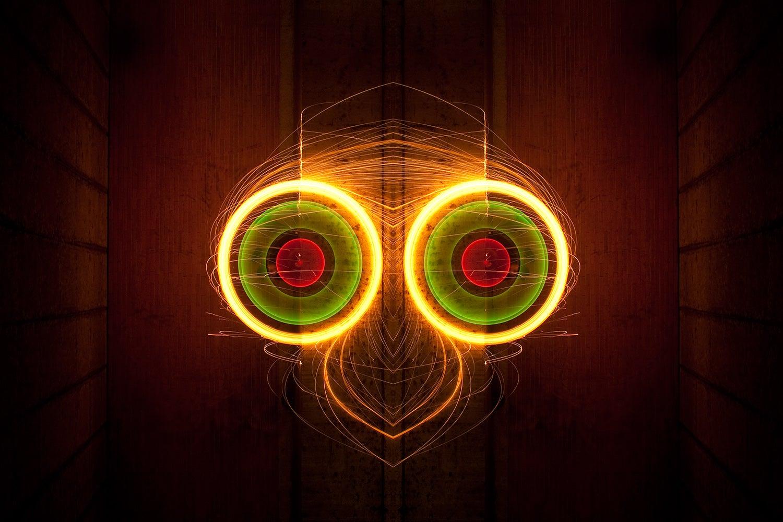 Light monster faces made of spinning molten metal