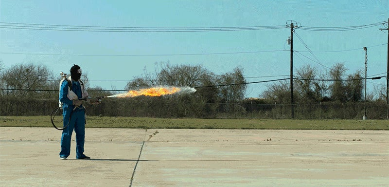 A Flamethrower In Slow Motion Looks Like a Flying Dragon Made of Fire