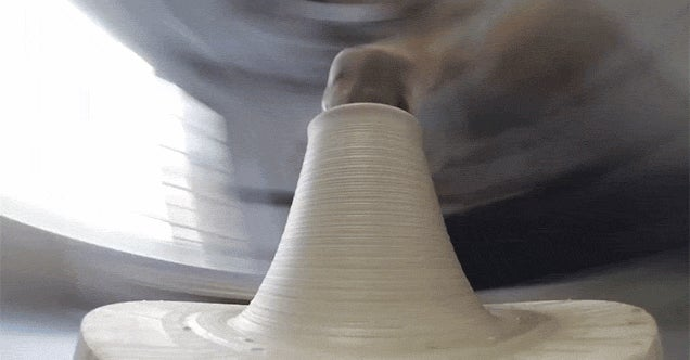 A Unique View of a Potter's Wheel Shaping Clay