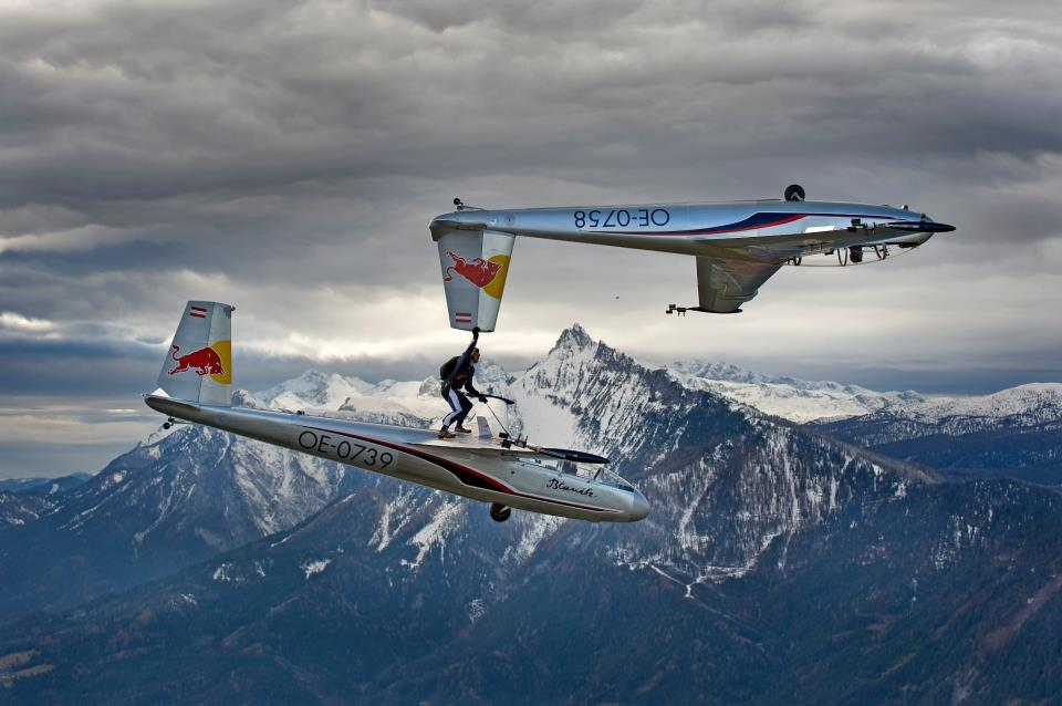 Amazing Video Of A Man Holding A Glider While Flying On Another Glider