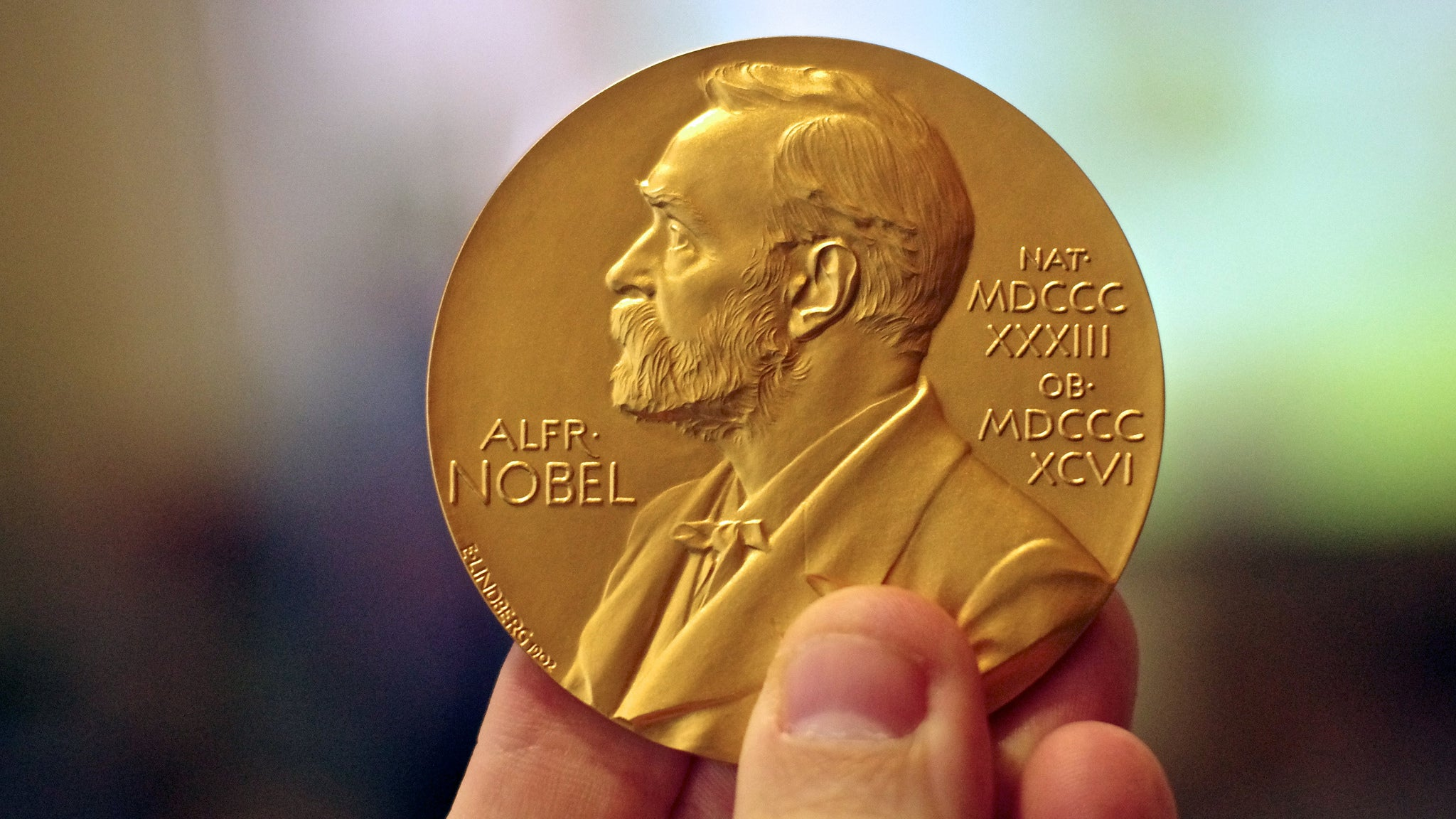 Nobel-Winning Physicist Worried About 100 Chocolate Coin Wager Over New Particles