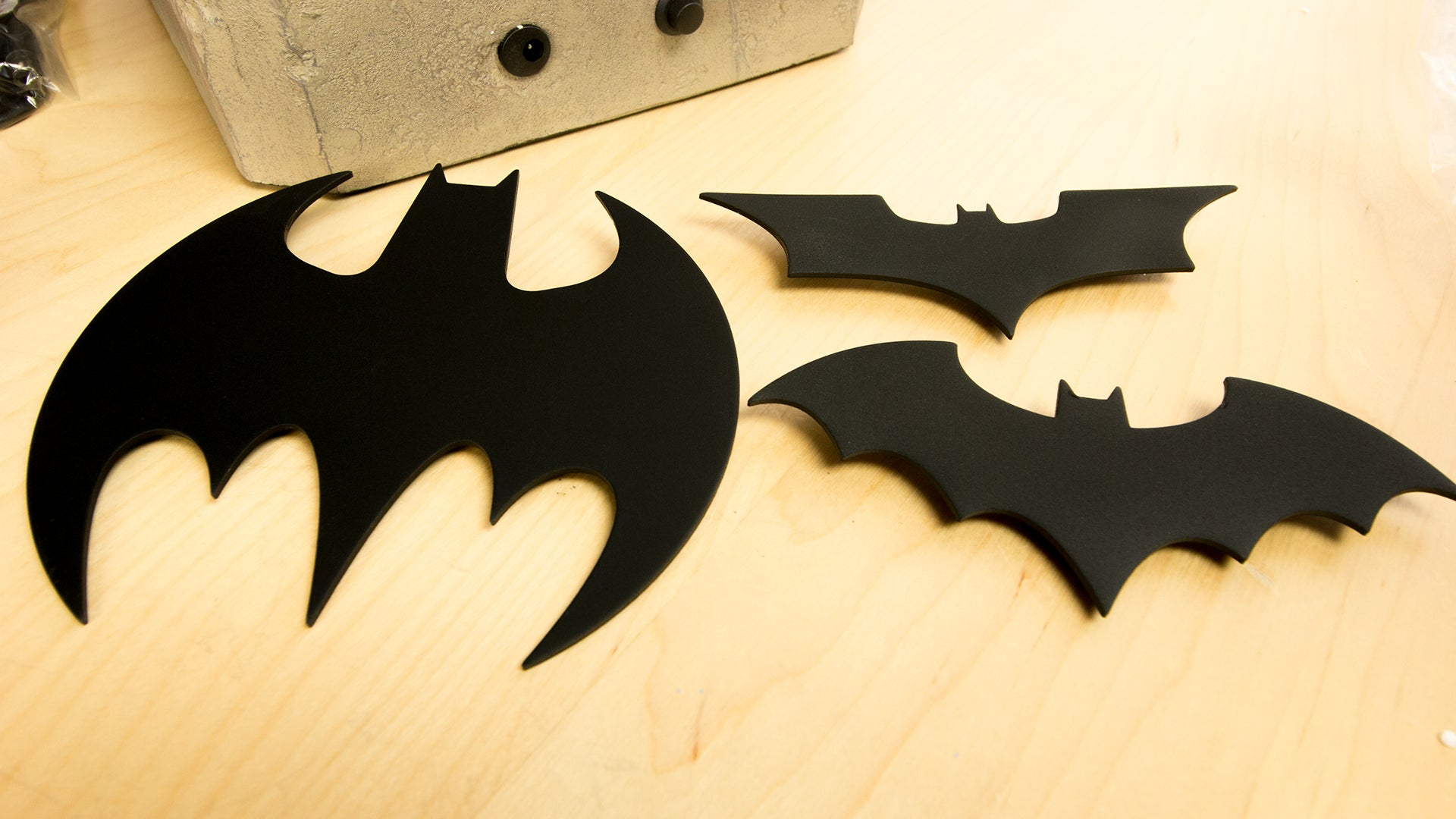 For just 300 you can own a tiny bat signal batman not included then slap on the searchlight hogging dark knight trilogy symbol if youre more of a comic book fan you can choose between modern and classic symbols buycottarizona Image collections