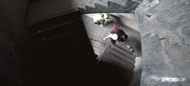 Two guys race up a 27-story building and jump down from the top