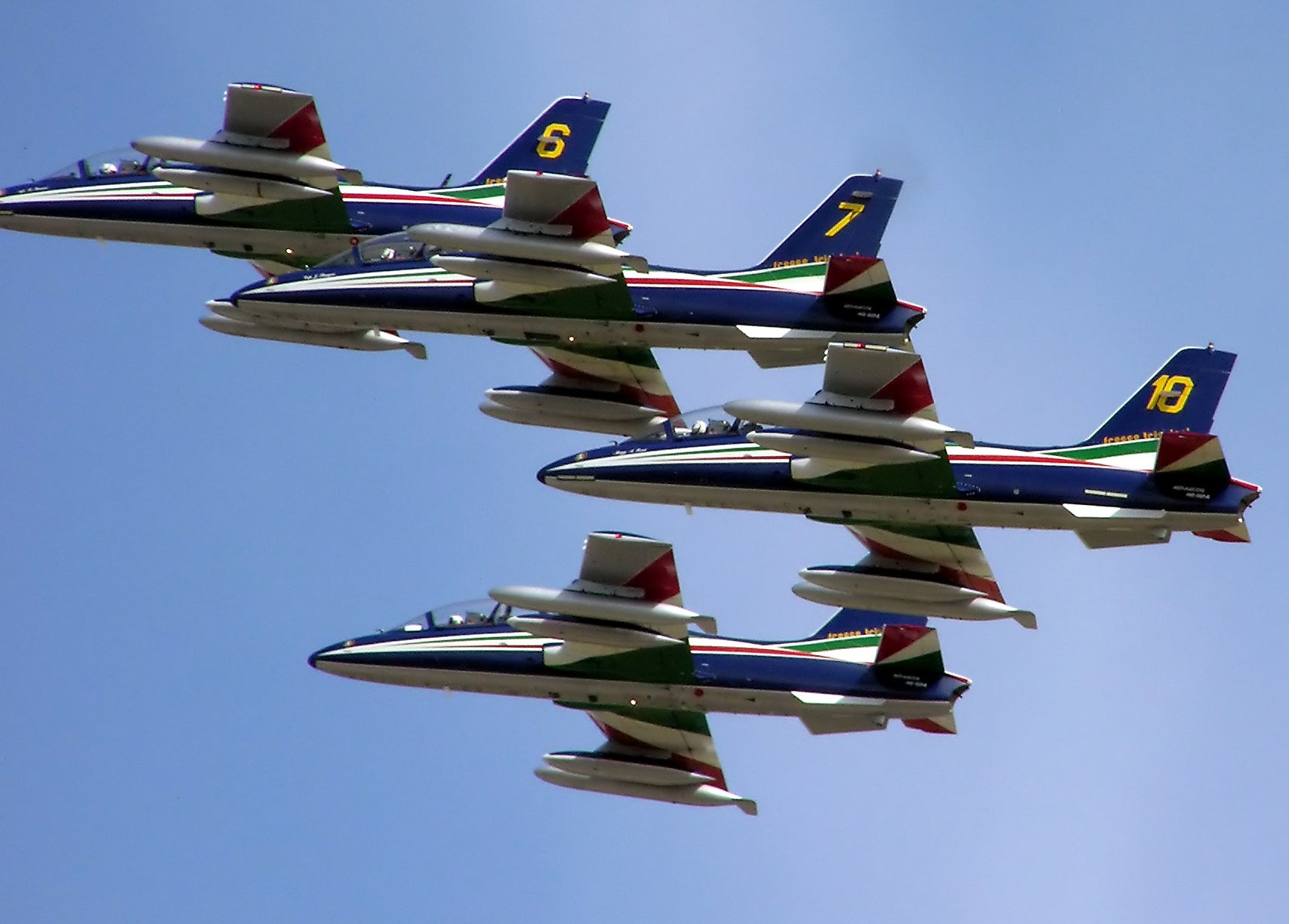 Watch seven jets landing in perfect formation