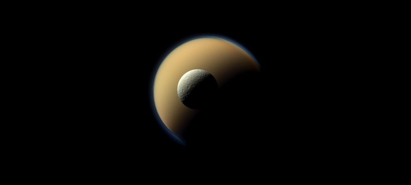 Saturn's Two Largest Moons — Rhea And Titan — Line Up For The Cassini Orbiter