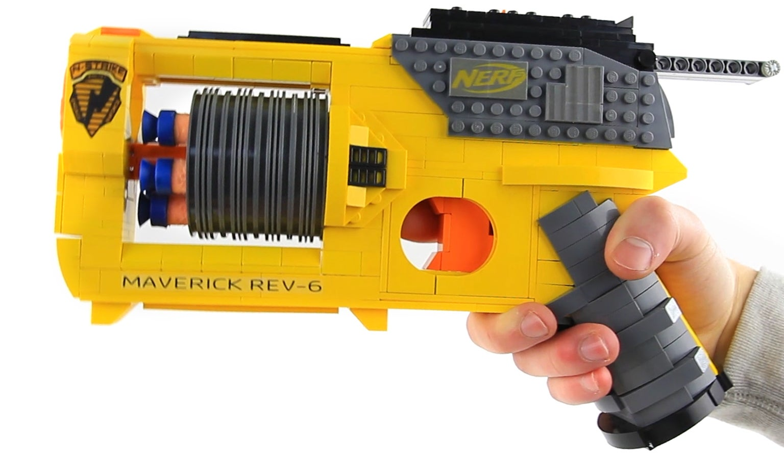 ... YouTube's Astonishing Studios has managed to recreate a working version  of the classic Nerf Maverick REV-6 blaster using nothing but plastic bricks  and ...