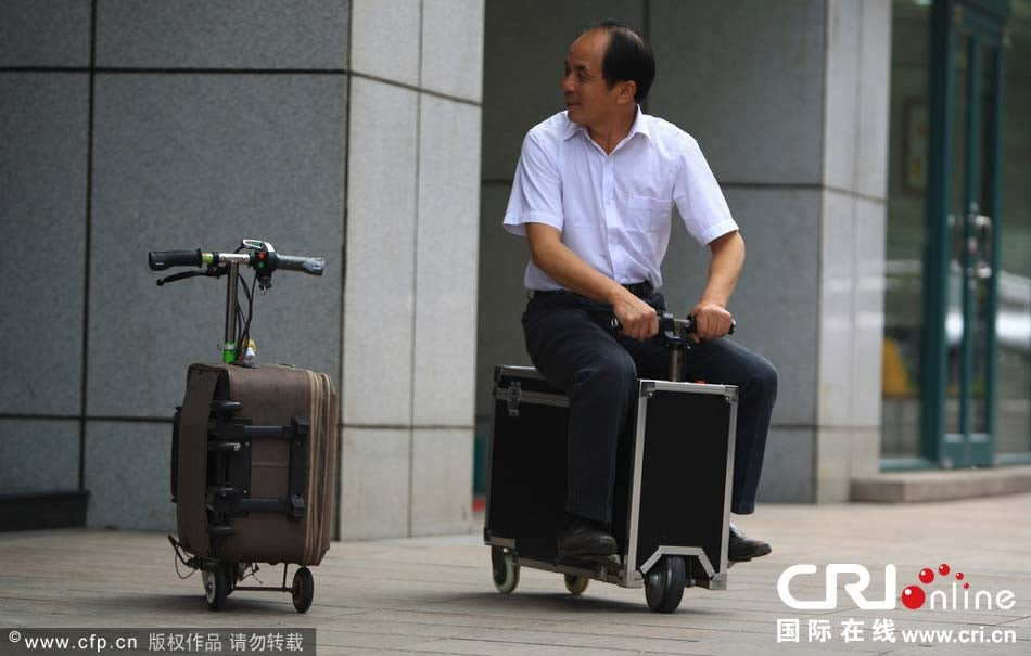 This Chinese farmer is recycling suitcases into electric scooters