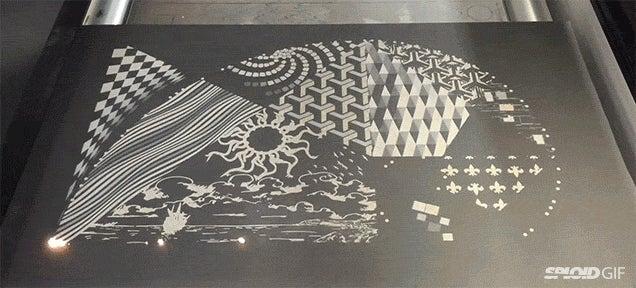 Watch an incredible laser beam zap out art at blazing speeds