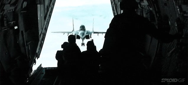 Video: MiG-29 flies impossibly close to an aeroplane's open rear door